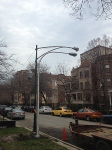 New piggy-back style light, next to the old light on Kenmore.