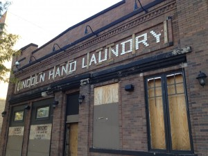Lincoln Hand Laundry sign revealed under old Pepitone's facade.  Credit: Jeremy Bressman